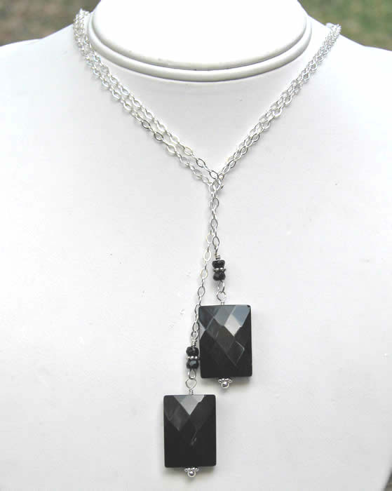 Sterling silver lariat with faceted black onyx rectangle beads and small faceted black onyx rondelle beads