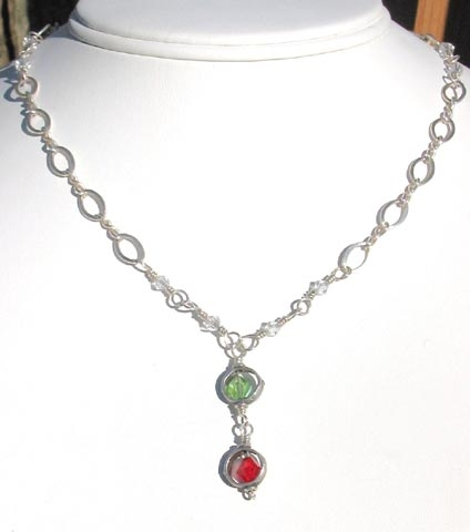 sterling sliver necklace with drop featuring Swarovski crystal birthstones