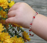 child's birthstone bracelet on handmade sterling silver chain